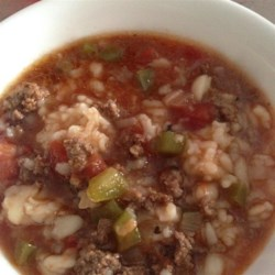 Stuffed Pepper Soup IV Recipe - This easy soup tastes just like stuffed peppers. With ground beef, rice, and plenty of green bell peppers, you'll have a hearty meal all in one pot.