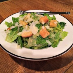 Canadian Caesar Salad Recipe - There's a little added heat in this Canadian twist on traditional Caesar salad, with hot English mustard and a dash of hot pepper sauce.