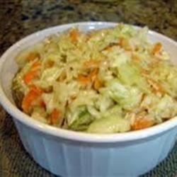 Spectacular Overnight Slaw Recipe Recipe - This make-ahead slaw recipe is packed with peppers, cabbage, carrots, and olives and is perfect for potlucks.