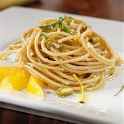 Nina's Best Citrus Pesto Spaghetti Recipe - A mixed blend of nuts and cheese with orange zest and basil makes a fabulous pesto sauce to toss with Barilla Whole Grain Spaghetti.