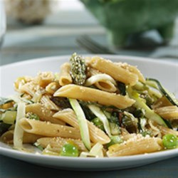 Gorgeously Green Penne Spring Pasta Recipe - Sauteed spring veggies tossed with penne pasta and a parsley-walnut topping is a refreshing weeknight meal.