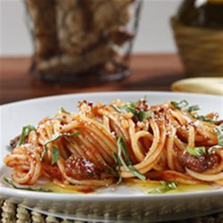 Spaghetti with Buffalo and Tomato and Basil Sauce Recipe - Lean ground buffalo in a spicy marinara sauce simmered with red wine brings gourmet flavors to this quick weeknight spaghetti dinner.