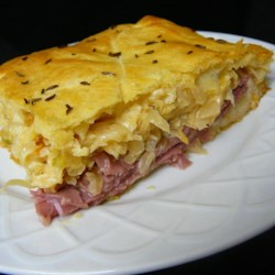 Reuben Crescent Bake Recipe - A pot pie made with refrigerated crescent roll crust has the flavors of a reuben sandwich. It's a great way to use up extra corned beef.