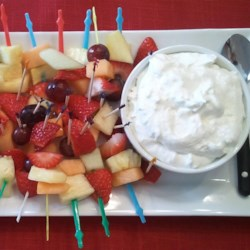 Fruit Dip Recipe - Serve this pineapple flavored dip made with marshmallow cream, whipped topping and cream cheese accompanied by skewered chunks of seasonal fruits.