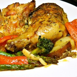 Book Club Herb Roasted Chicken and Vegetables Recipe - Chicken, fingerling potatoes, and vegetables marinate in a mixture of herbs and olive oil and are roasted until tender and flavorful.