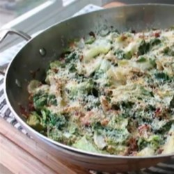 Utica Greens and Beans  Recipe - Escarole paired with cranberry beans and pancetta makes the perfect dish to start the New Year!