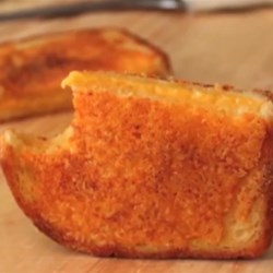 Inside-Out Grilled Cheese Sandwich   Recipe - Made with white bread, extra sharp Cheddar cheese, and butter, this crispy, crunchy, cheesy masterpiece is the ultimate grilled cheese sandwich.