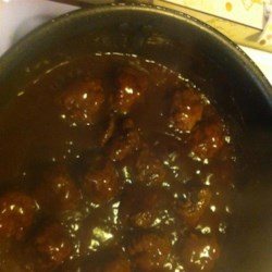 Oven Meatballs Recipe - It's super-easy to bake these ground beef meatballs in a tangy-sweet sauce.