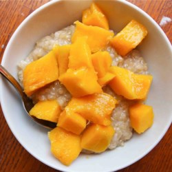 Mango with Sticky Coconut Rice (Kao Niaw) Recipe - Kao niaw, sticky rice with coconut and mango, is a delightful Thai-inspired dessert. Try it for a sweet breakfast too!