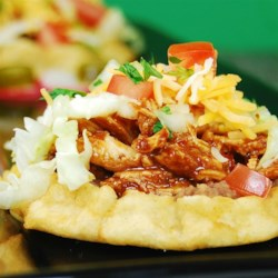 Easy Mexican Sopes Recipe - Mexican sopes are fried corn tortillas that can be filled with beans, cheese, and meat for a festive appetizer that will be the hit of the party.