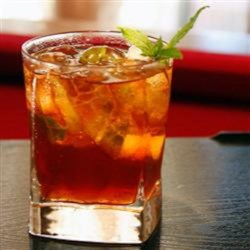Tropic Tea Recipe - This tropical iced tea with spearmint and pear vodka is the perfect pick-me-up on a hot day.
