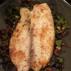 Tilapia Feta Florentine Recipe - The Mediterranean flavors you love, including olive oil, lemon, garlic, and feta cheese, are combined in a quick fish dish served Florentine-style with fresh cooked spinach.