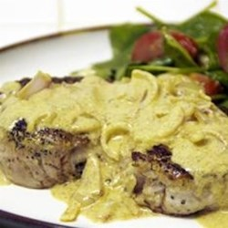 Boneless Pork Chop with Shallot Mustard Sauce Recipe - Seasoned boneless pork chops are served with a creamy shallot and mustard sauce creating a quick weeknight dinner. Serve with a nice green salad.