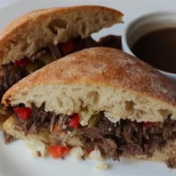 Chicago-Inspired Italian Beef Sandwich  Recipe - Combine the traditional Italian beef sandwich with the French dip sandwich and throw in a nod to the pulled pork sandwich and voila; the Chicago-inspired Italian pulled-beef sandwich!