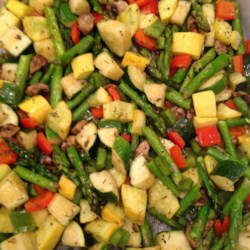 Whitney and Ashley's Flawless Roasted Vegetables Recipe - Zucchini, yellow squash, red bell pepper, and onions are tossed with olive oil and herbs and roasted until just tender in an easy-to-clean-up parchment-lined pan.