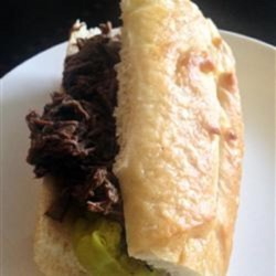 Slow Cooker Italian Beef Sandwiches Recipe - Slowly-cook a rump roast to tender perfection, shred the meat, and serve on French rolls with pepperoncinis for delicious Italian beef sandwiches.