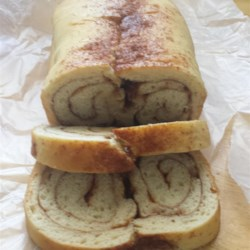 Cinnamon Swirl Bread for the Bread Machine Recipe - Use the dough cycle of your bread machine to make two delicious loaves of cinnamon-walnut bread. Once the dough is ready, it's simple to form the spiral loaves and bake them in the oven. Your house will smell like heaven.