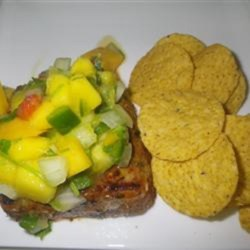 Mango Ceviche Recipe - This mixture of mango, onion, bell pepper, chile pepper, cilantro, and lime juice is ideal for topping blackened or grilled meat.