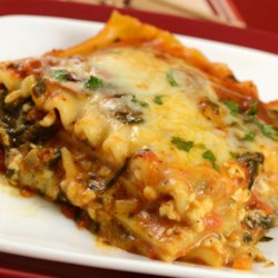 Simple Spinach Lasagna Recipe - Spinach with three types of cheese and herbs, layered with red sauce and noodles.