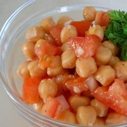 Preety's Chickpea Salad Recipe - A chickpea salad garnished with lemons.
