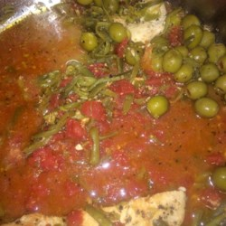 Quick Mediterranean Chicken Recipe - This is a quick, one-dish meal using frozen chicken breasts with cans of green beans, olives, and tomatoes.  Upon arriving home from running errands all day, I realized I had not taken anything out of the freezer, so this is what we ended up with for dinner!