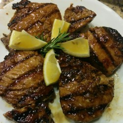 Grilled Yellowfin Tuna with Marinade Recipe - This recipe for grilled yellowfin tuna steaks features a lemony marinade with garlic, mustard, and soy sauce.