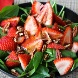 Strawberry and Spinach Salad with Honey Balsamic Vinaigrette Recipe - This is a great, easy summer salad with a lot of options as to mixing and matching. When the Gorgonzola cheese and balsamic vinaigrette combine it gets all tart and creamy!