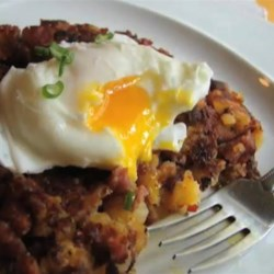 Chef John's Corned Beef Hash Recipe - A little roasted tomato salsa is the secret ingredient in this recipe for Chef John's corned beef hash.