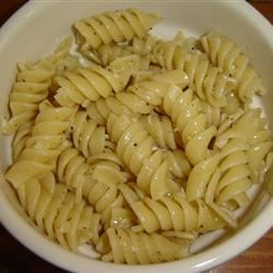 Fried Garlic Pasta Recipe - This is for garlic lovers! Tiny pieces of garlic are fried in olive oil and served over pasta, then topped with Parmesan cheese. Don't be scared off by the amount of garlic used, it caramelizes and sweetens as it fries in olive oil. It has become a favorite in my family, including my kids.