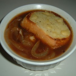Lance's French Onion Soup Recipe - Match this standard onion soup with a bottle of Zinfandel and a green salad for a delicious supper.  Yellow or white onions are mixed with beef broth, a teaspoon of sugar, and some white wine.  Topped with sliced French bread and shredded Swiss.  Deliciou
