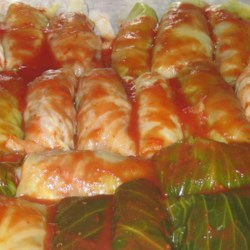 Slovak Stuffed Cabbage Recipe - Here's a five-generation family favorite. Parboiled cabbage leaves are stuffed with a mix of ground beef, ground pork, and rice, layered with sauerkraut and bacon, and baked.