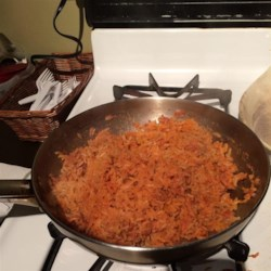 Easy Authentic Mexican Rice Recipe - This Mexican rice is cooked with onion powder, garlic powder, and tomato sauce for an easy side dish finished in under half an hour.