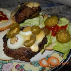 Skippy Burgers Recipe - Beer and bread crumbs hold together these big juicy burgers and make them extra delicious. You'll have a good time grilling these with friends.