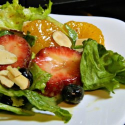 Jenny Allen's Fruit Salad Recipe - This light and refreshing salad mixes the sweetness of strawberries and blueberries with a zesty homemade vinaigrette dressing.