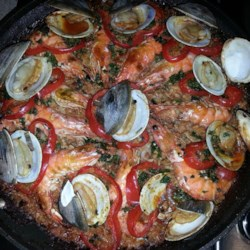 Authentic Paella Recipe - Paella is just about the most elegant one-dish meal anywhere, but surprisingly, it is not hard to make. This recipe has seafood and chicken, and those magical saffron threads that provide its fragrant flavor.
