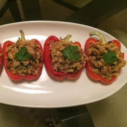 Bela's Stuffed Red Bell Peppers Recipe - Red bell peppers are baked, then stuffed with brown rice, chard, and black-eyed peas.