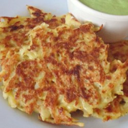 Ed's Potato Pancakes Recipe - Mix shredded potatoes with eggs, onion, garlic powder, and a little salt and pepper to make these delicious potato pancakes.
