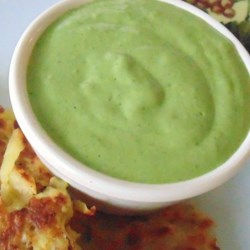 Creamy Cilantro Pesto Sauce Recipe - This deliciously creamy topping made with cilantro, basil, and cream cheese is great for chicken or fish.