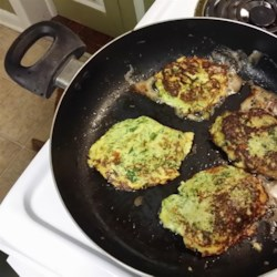 Low Carb Zucchini Pancakes Recipe - Freshly grated zucchini is mixed with fresh herbs and spices for a flavorful and simple pancake. Serve with sour cream, salsa, or cream cheese!