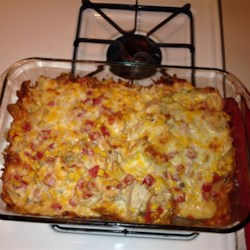 Chicken Dorito(R) Casserole Recipe - Nacho cheese-flavored chips are layered with a creamy tomato sauce, shredded chicken, and Mexican cheese blend for a quick and easy weeknight casserole.