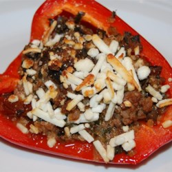 Tina's Greek Stuffed Peppers Recipe - Orzo pasta and ground lamb mix with tomatoes and spinach for a delicious filling in this stuffed pepper recipe.