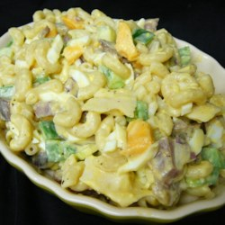 Dad's Working Man's Macaroni Salad Recipe - Beef bologna and American cheese will make this hearty macaroni salad stand out from the crowd.