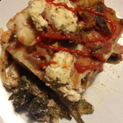 Vegetarian Lasagna Recipe - Layers, layers, and more layers. That 's what lasagna is all about. It begins with a layer of tomatoes, then veggies--carrots, zucchini, squash, eggplant, broccoli, and carrots--then noodles, cheese, and repeat!