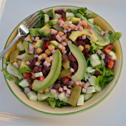 Avocado and Ham Salad Recipe - This recipe makes a big salad of Romaine lettuce, arugula, and mixed greens tossed with ham, beans, avocado, cucumber, tomato, sweet pepper, and radishes.