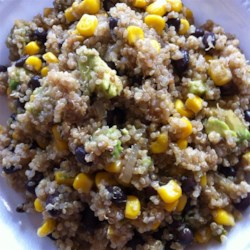 Cilantro Lime Quinoa Recipe - Mango, avocado, and cilantro are folded into nicely seasoned quinoa for a colorful and hearty summer side dish.
