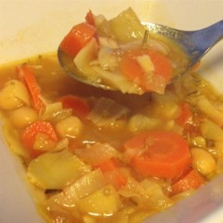 Artichoke and Chickpea Stew Recipe - This stew of artichoke hearts, chickpeas, and tomatoes, is seasoned with sage and lemon.