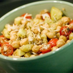 Chickpea Salad II Recipe - A tasty, filling version of a classic Mediterranean salad with chickpeas, tomatoes, cucumber, and onions tossed with Parmesan cheese, herbs, olive oil, and balsamic vinegar.