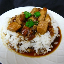 Sweet Sriracha Chicken Recipe - Chicken is simmered in a sweet and spicy sauce until tender and falling apart in this heavenly recipe that is fantastic over rice.
