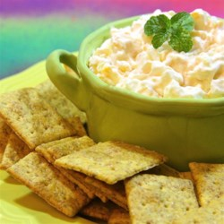 Pineapple and Cheese Spread Recipe - Pineapple is stirred together with Cheddar cheese, Neufchatel cheese, and sweet onion for a sweet and savory spread.