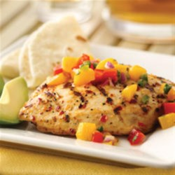 Spicy Grilled Chicken with Mango Salsa Recipe - Spicy grilled chicken with fresh colorful salsa is perfect for any summer cookout.